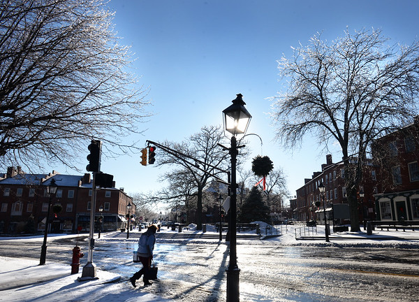 BRYAN EATON/Staff photo. Branches covered with ice glisten in Newburyport's Market Square on Wednesday.