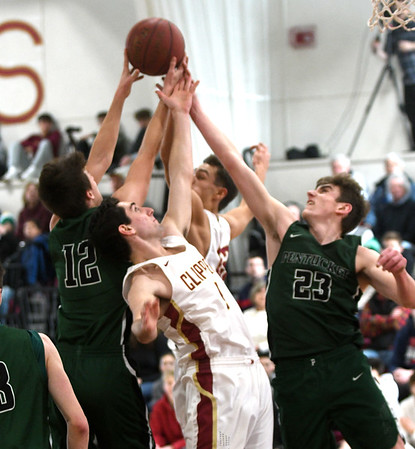 JIM VAIKNORAS/Staff photo Newburyport's Harry Bovee,#1, and Casey McLaren, #22, gight for a rebound with Pentucket's Peter Cleary, #12, and Jake Etter, #23 Monday at Newburyport High School.