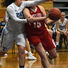 BRYAN EATON/Staff photo. Triton's Bridget Sheehan collides with Mary Bullis with no foul being called.