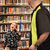 "BRYAN EATON/Staff photo. Olivia Catalfamo, 8, of Rowley gets into the act with magician Greg McAdams as she holds a magic wand to turn four pieces of material each with a letter h, e, r and o on them which he stufffed into a bag and out came one piece of material with the word ""hero on it."" He was performing his magic and comedy at the G.A.R. Memorial Library in West Newbury sponsored by the Friends of the Library."