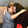 JIM VAIKNORAS/Staff photo Judy Adams hugs Chalis Barrett in Brentwood NH Friday. The Barrett's daughter Madison was killed in an automobile accident this past summer and her heart was transplanted into Adams.