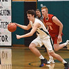 BRYAN EATON/Staff photo. Pentucket's Peter Cleary breaks away from Blake Bennett.