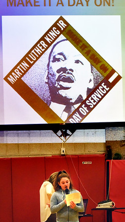 BRYAN EATON/Staff photo. Bela Francis, 9, and other members of the Cashman School Student Council took turns reading about Marting Luther King at an all-school assembly at the Amesbury school.