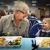 BRYAN EATON/Staff photo. Immaculate Conception School pre-kindergartner Scarlett Lebonte, of Amesbury has a pizza lunch with MemMem, a.k.a. Kathy Bourgault of Wenham who is a family friend and a surrogate grandmother to the four year-old. They were at the Newburyport school's VIP Luncheon, one of the events there for Catholic Schools Week.