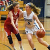 BRYAN EATON/Staff photo. Triton's Caitlin White maneuvers her way past Amesbury's Ciara Sullivan.