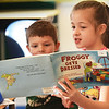 "BRYAN EATON/Staff photo. Sam Harp, 5, listens as Nicole Floriano, 9, reads ""Froggy Gets Dressed"" at the Bresnahan School in Newburyport on Friday morning. Pre-kindergartners are paired with the same third-graders for ""Reading Buddies"" every Friday which helps them foster social skills and friendship as they may wave to each other when they pass in the hallways."