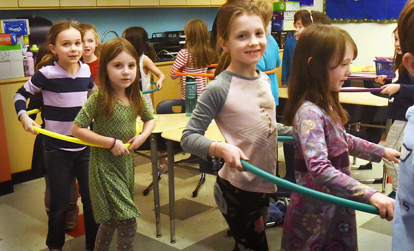 BRYAN EATON/Staff photo. First-graders in Christine Platt's class at the Bresnahan School parade through the classroom on Wednesday. Occupational therapist Trisha Dolan had children get into hula hoops while teaching them about personal space, how to respect each others  and how it affects them depending on different circumstances.