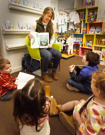 "BRYAN EATON/Staff photo. Author Alexis Pearson reads her children's book ""The Adventures of Turbo"" which is loosely based on the adoption of her dog, to children at a book signing at Giggles toy store in Amesbury on Sunday. The Salisbury native and Triton graduate, whose parents live in Amesbury, now resides in South Carolina."