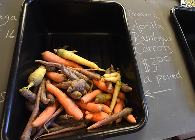 BRYAN EATON/Staff photo. Produce is local when possible, these carrots from Aprilla Farm in Essex.