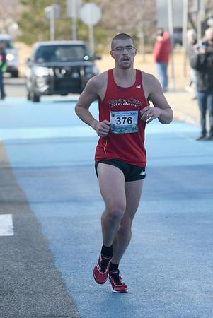 JIM VAIKNORAS/Staff photo Winner.. of the 5k race at the Hangover Classic at Salisbury Beach Tuesday.