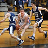 BRYAN EATON/Staff photo. Triton's Kyle Odoy moves down court as Hamilton-Wenham's William Whelan, left, and Carter Coffey cover.