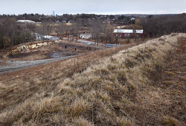 BRYAN EATON/Staff photo. The water tower adjacent to Anna Jaques Hospital can be seen at top right in a view from the top of the Crow Lane Landfill. A solar farm is being proposed for the mound.