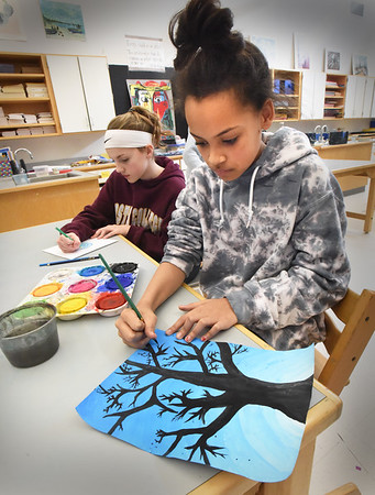BRYAN EATON/Staff photo. Ashley Jones, 12, left, and Madisyn Martin, 11, took recess inside Jen Bergeron's art room working on projects from the class at Salisbury Elementary School on Wednesday. Ashley was working on her design for ceramic tiles the sixth-graders make to line the hallways and Madisyn was finishing her tree silhoutte.