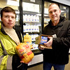 BRYAN EATON/Staff photo. Our Neighbors' Table executive director Lynsey Haight, left, with  Gary Terrio, warehouse  manager show some of the foods the Amesbury gets from the federal government through the USDA: chicken, orange juice and cheese. With the partial government shutdown the future of the food supply is uncertain.