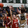 BRYAN EATON/Staff photo. Amesbury's Luke Martin covers Pentucket's Sam Stys.