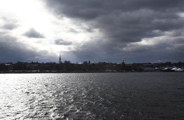 BRYAN EATON/Staff photo. A wintry view of the skyline of Newburyport is viewed over the Merrimack River on Thursday afternoon as the clouds began to break. Wintry is the word for the weekend as the temperature is not supposed to get over freezing.