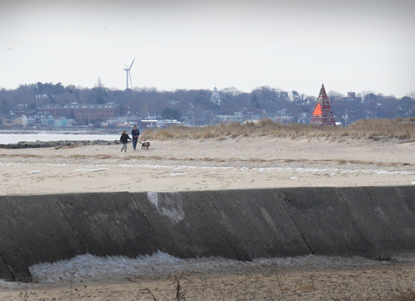 BRYAN EATON/Staff photo. Several dog-walkers were in the area of Ben Butler's Toothpick at Salisbury Beach State Reservation on a relatively calm Monday. Snow and rain is in the forecast for Tuesday night into early Wednesday morning with light accumulation predicted.