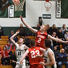 BRYAN EATON/Staff photo. Amesbury's Blake Bennett covered Pat Dillon on a missed shot.