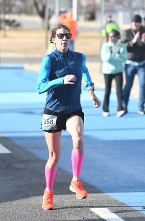 JIM VAIKNORAS/Staff photo Female winner.. of the 5k race at the Hangover Classic at Salisbury Beach Tuesday.