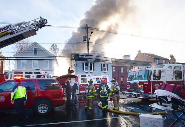 BRYAN EATON/Staff photo. Firefighters from surrounding communities aided the Newburyport Fire Department tackle a four-alarm fire at 155 High Street on Monday afternoon.