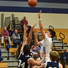 BRYAN EATON/Staff photo. Triton's Mason Ferrick shoots over Hamilton-Wenham defenders.