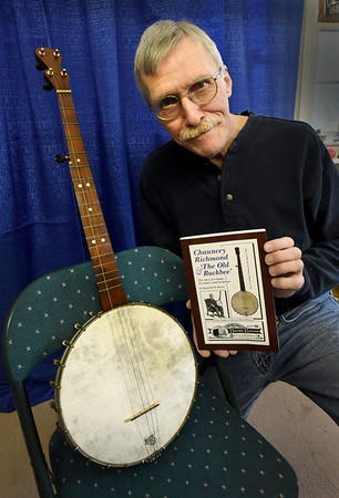 BRYAN EATON/Staff photo. Reg Bacon is a local author who wrote two history books that were published somewhat recently. The first is a book about this banjo from 1885 and its maker.