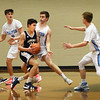 BRYAN EATON/Staff photo. Hamilton-Wenham's Carter Coffey looks for a way past these Triton defenders.