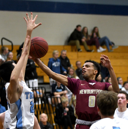 JIM VAIKNORAS/Staff photo Newburyport's George Coryell drives to the basket at Triton Friday night.