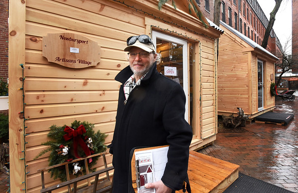 BRYAN EATON/Staff photo. Artist John Brown hopes to make the artisans village on Tracy Square in Newburyport permanent and have up to six cottages.