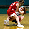 JIM VAIKNORAS/Staff photo Pentucket's Jess Galvin fights for a loose ball with Masconomet's Morgan Bovardi at Pentucket Friday night.