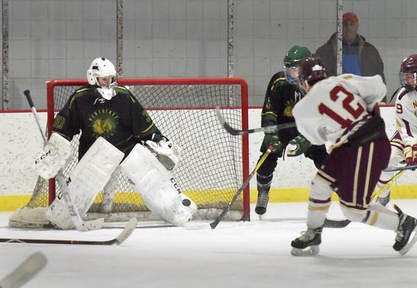 BRYAN EATON/Staff photo. Newburyport's Ryan Archer attempts a shot on goalie Brady McClung.