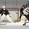 BRYAN EATON/Staff photo. Newburyport's Ryan Archer attempts a shot on goalie Brady McClung.