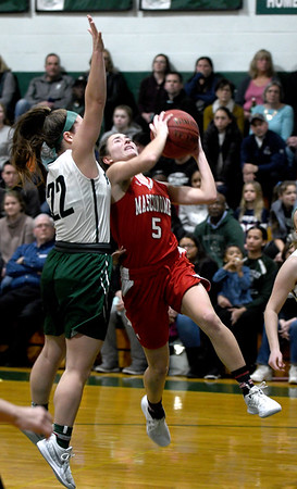 JIM VAIKNORAS/Staff photo  Masconomet's Paige Richardson drives on Pentucket's Angelina Yacubacci at Pentucket Friday night.