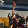 JIM VAIKNORAS/Staff photo Newburyport's Jacob Robertson with a lay-up at Triton Friday night.