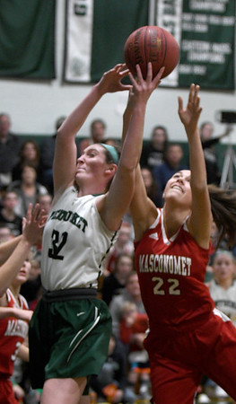 JIM VAIKNORAS/Staff photo Pentucket's Liv Cross fights for a rebound Masconomet's Callie McSweeney at Pentucket Friday night.