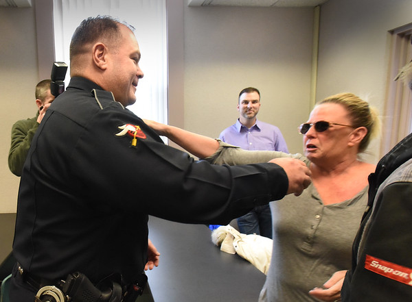 BRYAN EATON/Staff photo. Jackie Ames, right, got emotional as she met with Newburyport Police officer Eric Marshall who was first on scene last year when she had a heart attack at home, and was part of responders credited with saving her life.