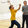 BRYAN EATON/Staff photo. Michael Dunphy, 12, left, and doubles partner Brent Barry, 12, have their eye on the shuttlecock in a game of badminton. The game is new at the Newburyport Rec Center where basketball usually dominates gym space.