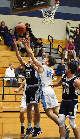 BRYAN EATON/Staff photo. Hamilton-Wenham's Carter Coffey and Triton's Quintin McHale go for the ball.
