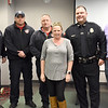BRYAN EATON/Staff photo. Jackie Ames, who suffered a heart attack last year is flanked by those credited with helping to save her life, from left, Newburyport Fire Department headquarters engine crew and EMT's Lt. Kevin Parseghian, Dennis Bligh, Fred Elwell, Newburyport police officer Eric Marshall and Atlantic Ambulance paramedic Patrick Brown.