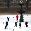 JIM VAIKNORAS/Staff photo Skates play hockey around the Swan Fountain on the Frog Pond at the Bartlet Mall in Newburyport Saturday.