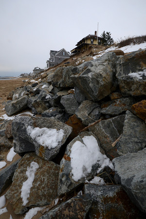 Newbury: Large boulders guard houses along the shore of Plum Island. Jim Vaiknoras/staff photo