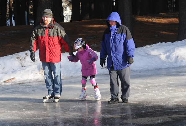 Amesbury: Julia Parsons, 6, skates with her dad Ryan Parsons and her grandfather Paul Bosse at Amesbury Park Wednesday. JIm Vaiknoras/staff photo