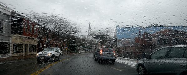 JIM VAIKNORAS/Staff photo Rain soaks downtown Amesbury Sunday afternoon.
