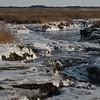 JIM VAIKNORAS/Staff photo Ice chokes the salt marsh long the Plum Island Turnpike in Newbury.