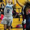 BRYAN EATON/Staff Photo. Triton's Hannah Clark gets two on this layup against Lynn Tech.
