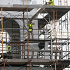 BRYAN EATON/File photos. Over two years of work on renovation of the First Religious Society's church and steele, also known as the Unitarian Church. Workers remove planks from the Unitarian Universalist Church as unneeded scaffolding is removed.