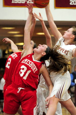 JIM VAIKNORAS/Staff photo Amesbury's Mikayla Porcaro (31) and Flannery O'Connor, (12) battle Newburyport's Kaitlyn Ahern for a rebound durig their at Newburyport High School.