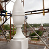 "BRYAN EATON/File photos. Over two years of work on renovation of the First Religious Society's church and steele, also known as the Unitarian Church. One of the four new fiberglass ""acorns"" is pictured on the steeple of the Unitarian Universalist Church in downtown Newburyport. They're replicas that replaced the wooden ones, part of the huge renovation project of the historic landmark."