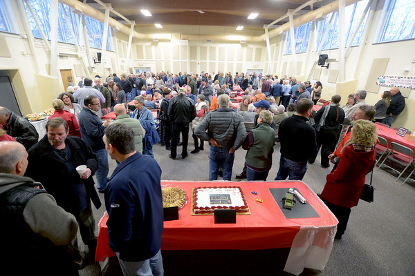 JIM VAIKNORAS/Staff photo Over 200 people showed up at a surprise party in honor of Dick and Matt Brunault at the Town Hall Annex in West Newbury Sunday afternoon. The pair recently sold their Main Street garage.