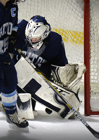 BRYAN EATON/Staff photo. Pentucket hosts Triton. The shot on net is close but Triton goalie Ben Fougere makes the save.